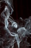 Smoke trail. White smoke trail on dark background stock photography