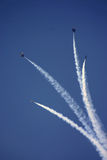 Smoke Trails. Jets breaking formation with Smoke at Air Show royalty free stock photo
