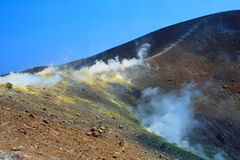 Smoke on the volcano. By a sunny day Royalty Free Stock Photography