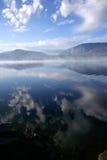 Smoke on the Water. Smoke floats across a mountain lake stock photography