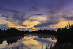 Smoke On The Water, Fire In The Sky. One of the autumn sunsets in the Northern Finland. Follow me on Twitter to see if your travel picture is on focus this week royalty free stock image