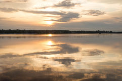 Reflections in water at sunrise by the river. Smoke on the water at sunrise by the river at the end of summer Royalty Free Stock Photos