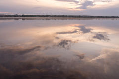 Reflections in water at sunrise by the river. Smoke on the water at sunrise by the river at the end of summer Royalty Free Stock Images