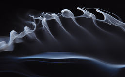 Smoke waves. Abstract background smoke with curly waves Stock Images