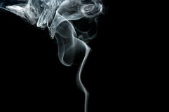 Smoke. White cigarette smoke forms on black background stock photo