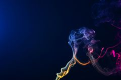 Smoke. White smoke on isolated black background Stock Photos