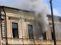 Smoke in the window Royalty Free Stock Photo