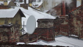 Smoke winter roof house. Smoke comes from the chimney of the house. The pipe on the roof. Winter cold stock footage