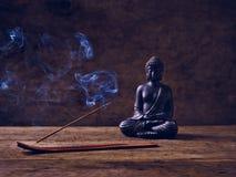 Smoke Wood Buddha joss stick Stock Photography