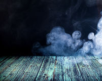 Smoke. Wooden floor against the backdrop of clouds of smoke Stock Photos