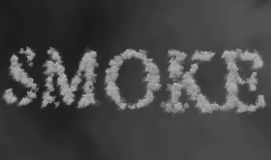 Smoke word made by floating smoke steam through space on grey blur background stock image