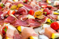 Smoked bacon appetizers on platter stock photo