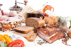 Smoked bacon with brown wholewheat sliced bread herbs Royalty Free Stock Photography