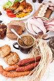 Smoked bacon with brown wholewheat sliced bread. Herbs and vegetables arrangement Stock Images