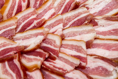 Smoked bacon, cut into pieces closeup Royalty Free Stock Image