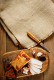 Smoked bacon, knife, sliced bread and canvas textile Royalty Free Stock Image