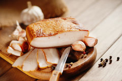 Smoked bacon, knife and sliced bread Royalty Free Stock Photo