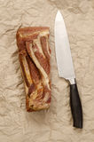 Smoked bacon and large knife Stock Image