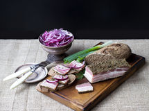Smoked bacon with onion and rye bread Stock Photo