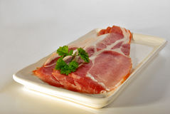 Smoked bacon on a plate Royalty Free Stock Photos