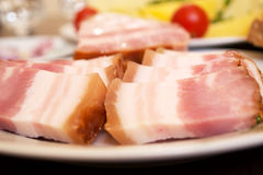 Smoked bacon. Smoked bacon with potatoes and onion - a good appetizer for a good company stock photography