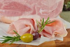 Smoked bacon with rosemary and olives Royalty Free Stock Photography