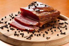 Smoked bacon with spices Royalty Free Stock Photo