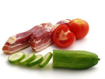 Smoked bacon with vegetables. Isolated on the white background Stock Photo