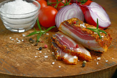 Smoked bacon and vegetables Royalty Free Stock Images
