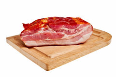 Smoked bacon on wooden board. Stock Photo