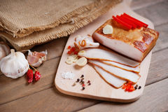 Smoked bacon on a wooden cutting board Royalty Free Stock Images