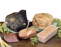 Smoked and baked ham and other stuffed meats Royalty Free Stock Photos