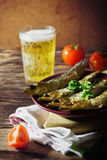 Smoked baltic herring. And fresh beer in a glass on the old wooden background. rustic style. selective focus Stock Photo