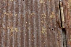 Smoked Barn Siding with Hinge. Smoked Metal Barn Siding with Hinge Background Royalty Free Stock Images