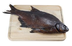Smoked bream on a wooden board Stock Images