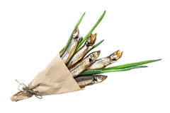 Smoked capelin with green onions in paper cornet Royalty Free Stock Images