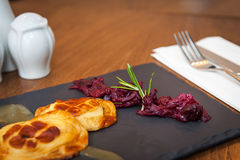 Smoked cheese with beetroots. Smoked cheese served with beetroots stock photography