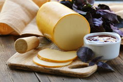 Smoked cheese with jam Royalty Free Stock Images