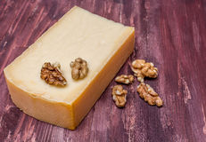 Smoked cheese and nuts. On a wooden kitchen table Royalty Free Stock Photo
