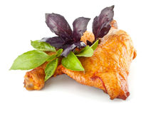 Smoked chicken with basil leaves royalty free stock images