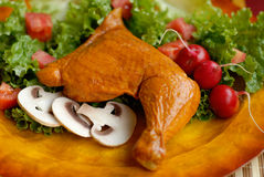 Smoked chicken leg with mushrooms Stock Images