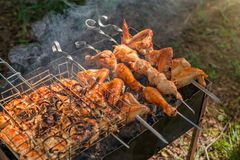 Smoked chicken skewers on the grill. Sunny day in spring royalty free stock image
