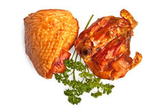 Smoked chicken thighs. Two smoked chicken thighs, green parsley with a light shadow on a white background stock photography