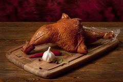 Smoked chicken thighs on the table Royalty Free Stock Photo