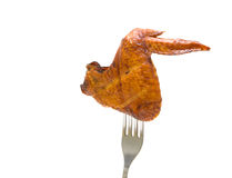 Smoked chicken wings on a fork. white background. Smoked chicken wings on a fork on a white background. horizontal photo Royalty Free Stock Images