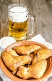 Smoked chicken wings with spicy sauce and glass of beer Stock Photography