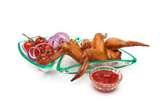 Smoked chicken wings and vegetables on a white background Royalty Free Stock Image