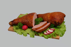 Smoked chicken on wooden board. Stock Photos