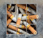 Smoked cigarettes Stock Images