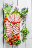 Smoked cold cuts with herbs and pepper Stock Photos